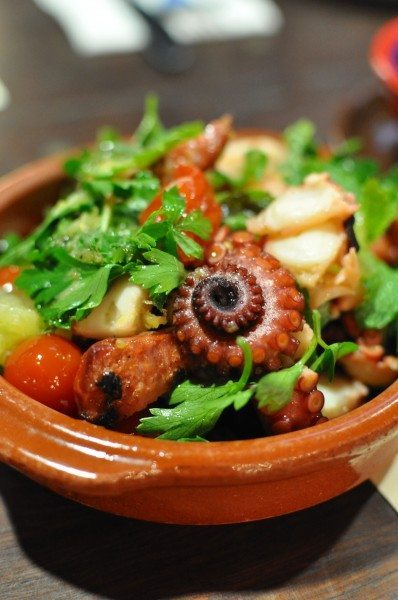 Pulpo con chorizo - grilled octopus, chorizo, fresh lime, parsley & tomato